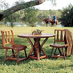 Dining, Western style. These side chairs are handcrafted of rustic teak wood reclaimed from old farm homes and ranching implements. Since teak is safe for the elements, you can dine indoors or under the stars. From King Ranch Saddle Shop.
