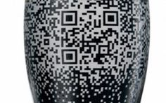 Fill this beer glass with Guinness and you can activate a QR code that tweets for your or checks you in to Foursquare.