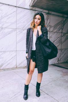 leather shorts, cream thin strap tank top, big gray cardigan