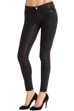 J Brand Mid-rise coated super skinnies. Leather look jeans without the sag. WANT.