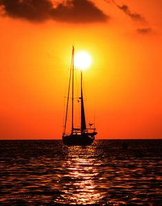 Sail Boat Anchored at Sunset.