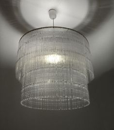 Awesome Plastic Coffee Spoon Lamp - designed by StudioVerissimo. Looks like it is made from Lucite #chandelier #recycled