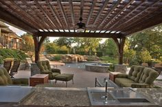 This cedar-pergola covered conversation area features a custom poolside bar complete with a state-of-the-art audio/video sound system. Photo courtesy of Baker Pools; photography by Archway Photography http://www.luxurypools.com/