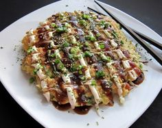 Okonomiyaki  1 cup all-purpose flour  1 tablespoon corn starch  ½ tsp baking powder  2/3 cup stock (dashi, and if dashi isn't available use any broth)  1 egg  2 cups finely shredded green cabbage  ½ lb medium shrimp (51-60 size)  3 green onions finely sliced  1 tablespoon canola or peanut oil  Garnishes:  Mayonnaise and Tonkatsu sauce (see below)  Finely minced green onions  Japanese Furikake seasoning (optional but very good-worth seeking out)  Combine the flour, cornstarch, and baking powde...