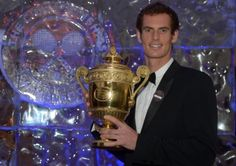 Andy Murray poses with the mens singles trophy during the Champions Ball at the Intercontinental Hotel, London. Picture: Adam Davy/PA Wire.