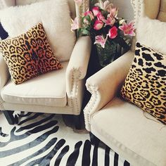 Love the animal print! - great idea for living room.