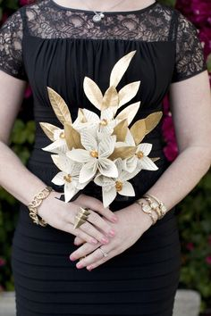 I handmade these bridesmaid bouquets using only recycled book pages, gold pipe cleaners, black ribbon, and gold leaf springs found at a craft store. Not a single flower was used at my wedding, inspired by my literary theme.