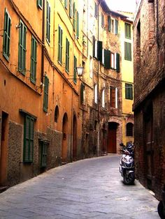 Sienna, Italy - A town built in 11AD that is so beautiful that you start to believe you are walking on a movie set.