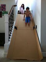 Stairs + cardboard box = amazing indoor slide!