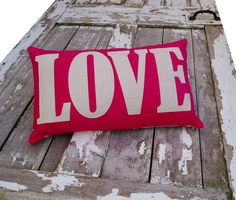 sale item LOVE word Cushion/pillow in hot by karenhiltondesigns, $35.00