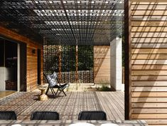 Geometric patterned screens encase a pair courtyards at this timber-clad beach house. beach houses, blairgowri hous, deck, courtyard