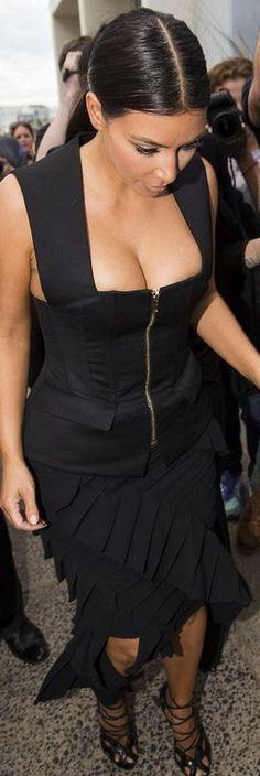 Kim Kardashian: Skirt – Lanvin  Shirt – Balmain  Shoes – Tom Ford