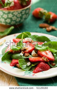 Salad: plated spinach salad with strawberries pecan and goat cheese
