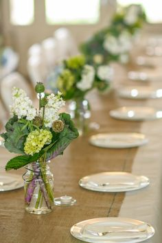 Done Brilliantly - Burlap table runner and floral centerpieces