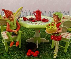 Strawberry fairy fun!  A miniature fairy serves up strawberry shortcake in your mini fairy gardens.