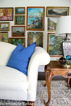 One of three decorated rooms from 7 Fabulous Bloggers!  eclecticallyvintage.com Flea market finds landscape paintings on art gallery wall
