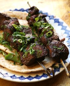 Pork Kebabs with Cucumber-Mint Yogurt Sauce - Redolent of oregano and cinnamon, these pork kebabs owe their tenderness to a red wine marinade that helps break down even the toughest cuts of meat, like pork shoulder, which is most commonly slow-cooked in the oven or on the stove top.