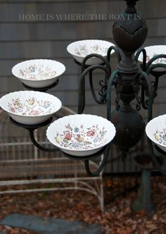 bird feeder from a old chandelier and plates