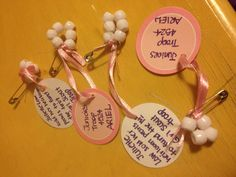 Swaps! Juliette Low sold her heirloom pearls to fund the first Girl Scout troop. We made these from white pony beads, stretchy magic string, safety pins and tags we found at Party City in baby shower section. Cost: beads 99cents/pk I bought 5 and had lots left over!, safety pins $2.99/500 pins, stretchy magic string 25yards ( we still have lots left over and did Jewelry badge with it too for 13 girls so it goes a long way)-$5.99, tags $1.99/pk of 24. We made approx 200 swaps+materials leftover