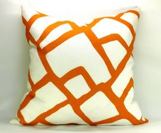 Orange and white pillow from Lab Designs