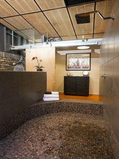LOVE the sunken but open tiled shower area! Master bathroom?