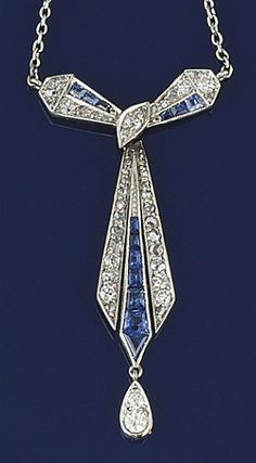 A sapphire and diamond pendant   Of stylised bow design suspending a pear shaped diamond drop, set throughout with old brilliant and rose-cut diamonds and calibré sapphire detail, to a fine chain. Art Deco or Art Deco style
