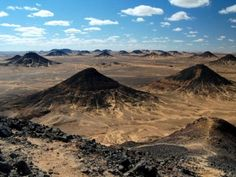 """Egypt not only has a """"White Desert"""", which I posted, but also a """"Black Desert"""". This black desert seems to be made of piles of shiny volcanic rock."""