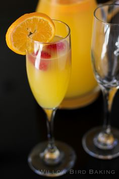 1 bottle of chilled Prosecco, 1/2 C Triple Sec, 3 C pulp-free OJ, orange slices & raspberries for garnish