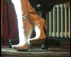 White patent boots with metal tips