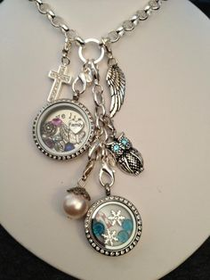 Origami Owl Living Locket.... FREE CHARM WITH A $25 OR MORE PURCHASE... Contact me to place your order YourCharmingLocket@gmail.com or message me on Facebook https://www.facebook.com/YourCharmingLocket. ---LIKE OUR FAN PAGE FOR A CHANCE TO WIN A FREE CHARM. 3 WINNERS EVERY MONTH---  Want more than just one locket, consider joining our team for an extra income.