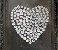 what a beautiful heart made of all white buttons on a silver tray, love it