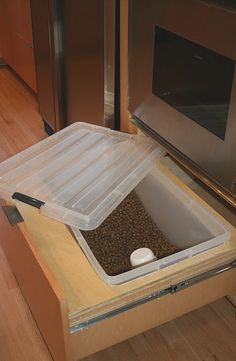 Hidden space for dog food. Pretty clever, but maybe not under the stove.