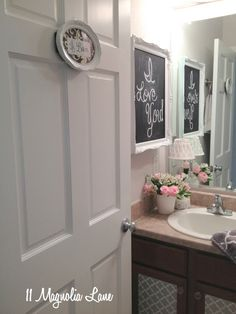 Put a chalk board into a picture frame and hang in on the ugly medicine cabinet!! Genius~