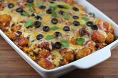 Tater Tot Bake-1lb ground beef, onion, garlic, olives, taco seasoning, corn, green chilies, black beans, shredded Mexican cheese blend, frozen tater tots, enchilada sauce Cooking Instructions: