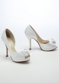 """This ultra-feminine and classic peep toe platform with rosette detail is sure to add glamour to any ensemble!  High heel D'Orsay platform peep toe features exquisite rosette detail.  Available in Champagne, Ivory and Silver.  Heel measures 4"""".  Fully lined. Imported."""