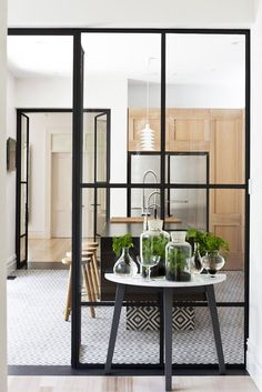 glass doors, glass walls, pattern tiles, steel framed doors, open kitchens, steel frame doors, black kitchen tiles, kitchen designs, patterned tiles