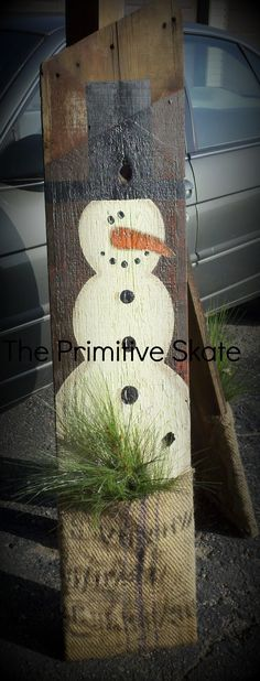 Old Barn Board & Burlap Bag...re-purposed into a primitive snowman decoration. Paint a snowman onto the piece of barn wood, cut a burlap bag in half & staple to the bottom to create a pocket and add some pine branches. So awesome...The Primitive Skate. Instructions included.