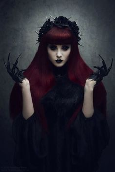 Fantasy makeup, hair and costume. She could be the hottest witch of the west. Burgundy hair, bang cut, dark makeup.