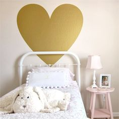 Add some love to a little girl's room with a wall decal like this metallic, gold heart.
