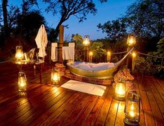 Return from game viewing in Botswana's Okavango Delta with a private bath for two under the stars. The staff at Sanctuary Baines Camp create a free-standing Botswana-style zinc bath tub lit by candlelit on the private viewing deck of the suites. Mobile canvas screens are placed to ensure complete privacy without obstructing the stunning views from the deck.