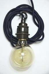 Talk about warming up a space...Edison light globes with rope cords...