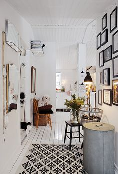 White entryway with black patterned floor.