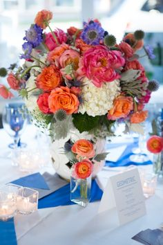 Blue, pink, and orange centerpiece- LOVE these colors! Photo by Sarah Roshan, see more: http://theeverylastdetail.com/dazzling-blue-wedding-ideas/