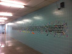 """Student-created bulletin board!    Each student colors their own note.  Underneath: """"We are each unique... but together we make a symphony!"""""""
