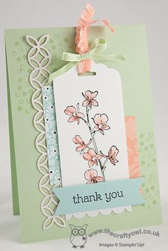 Pretty pastel colors and an orchid stamp on a scalloped tag create a unique handmade thank you card.  You could also create a little pocket for the tag so it could be removed and used as a bookmark.
