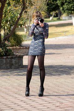 Tight mini dress with black tights on a curvy body