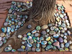 painted rocks instead of mulch - how fun LOVELY...KEEP SUPPLIES AT HAND... A NEWCOMER COMES WITH,...FEELS OUT OF PLACE...HAND THEM A ROCK AND A FEW SHARPIES