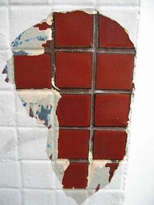 How to Paint Ceramic Tile Floor - this made me think of getting an old window and paiting a state/country on it (thought this looked like Africa)