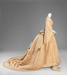 Wedding ensemble (side view) by Courvoisier, American, 1870. Silk dress, petticoat, and shoes with leather gloves.
