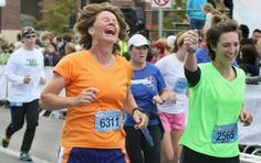 Sharon Turner of Milo, left shows elation along with the Tiffany Chumbley, also of Milo, as they complete the half marathon Sunday.